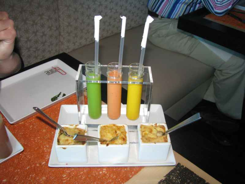 Test Tubes of soup with a straw. Pastry servings below soup different