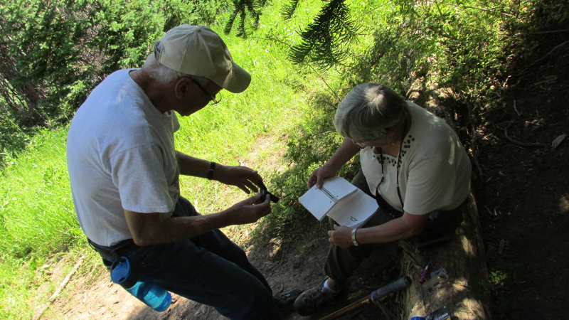 Tugman and Wifey signing the log